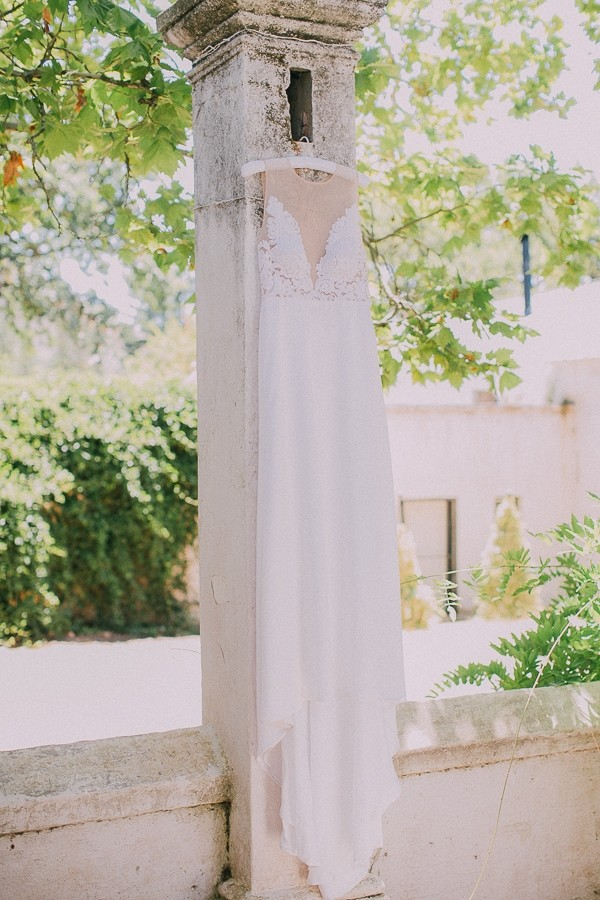 Wedding dress hanging from pillar