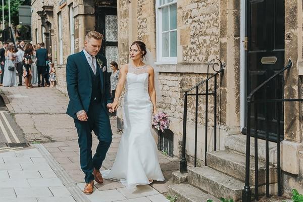 Bride and groom walking in town