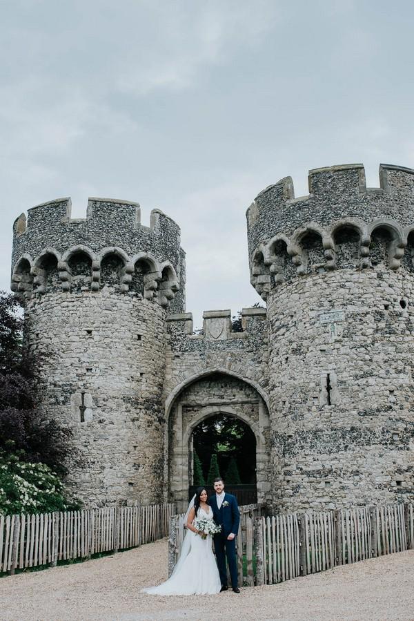 Bride and groom outside Cooling Castle Barn wedding venue