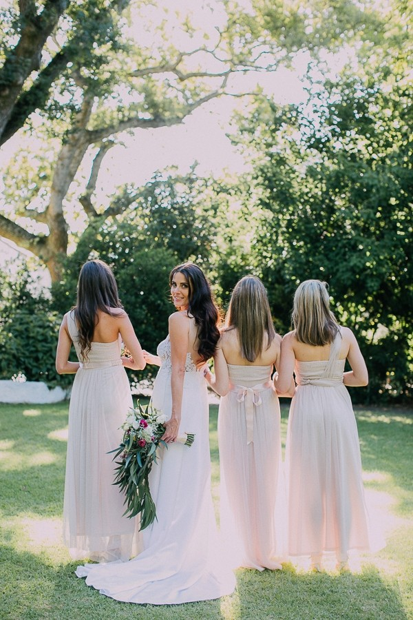 Back of bride and bridesmaids' dresses