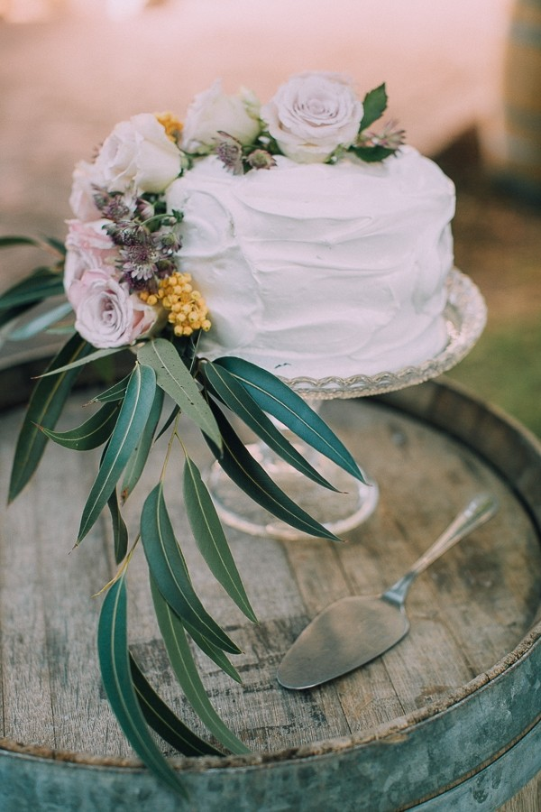 Simple wedding cake with flowers and foliage