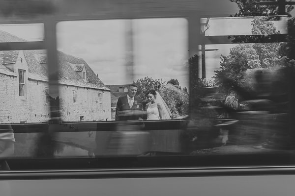 Bride and groom seen through window of passing bus