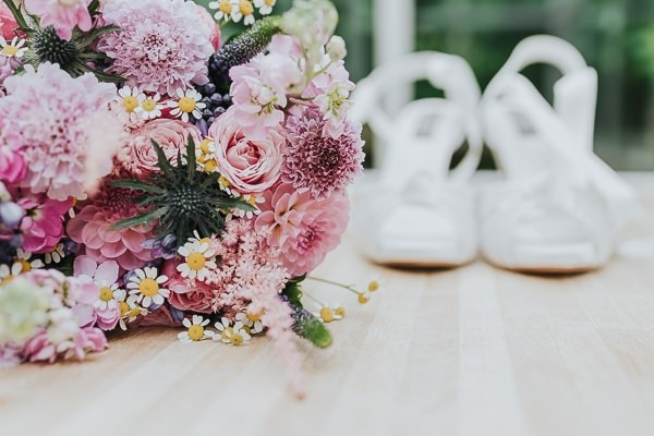 Bridal bouquet with pink flowers, thistles and daisies