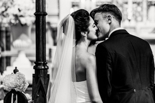 Bride and groom kissing - Picture by Damion Mower Photography