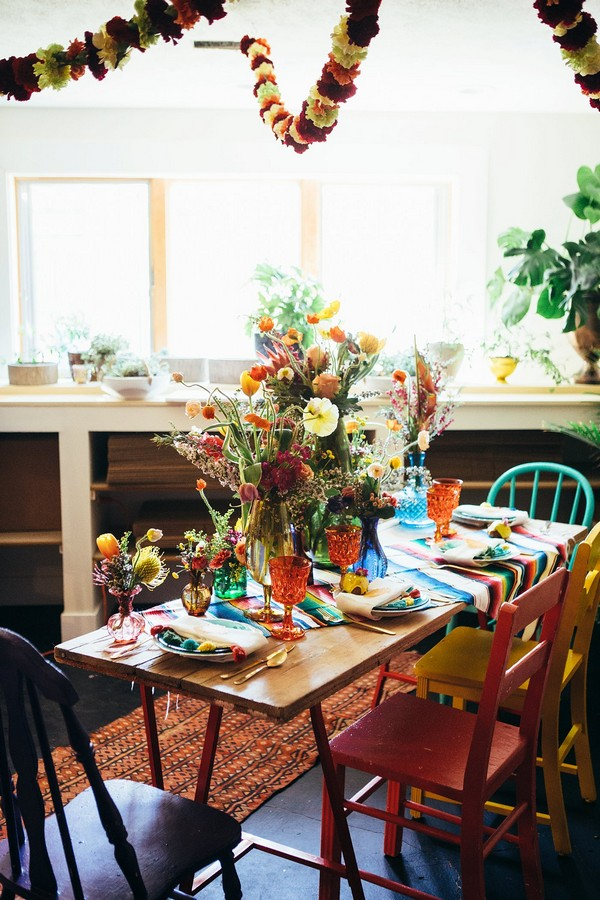 Table dressed with colourful flowers and tableware