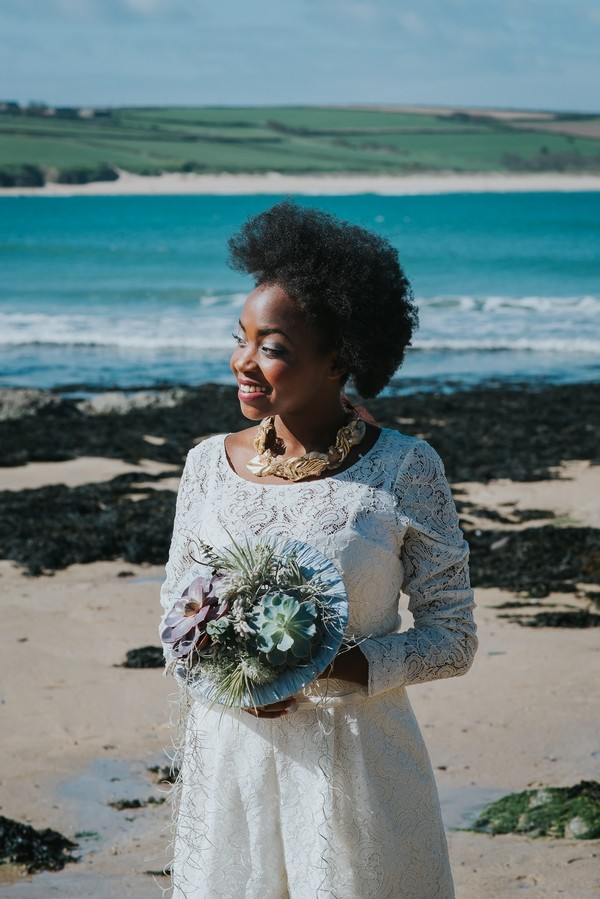 Bride with afro holding bouquet