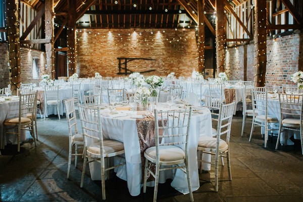 Wedding tables in Cooling Castle Barn