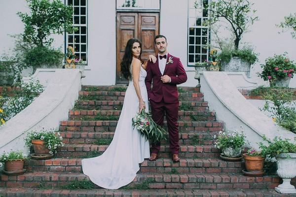 Bride and groom on steps of Natte Valleij