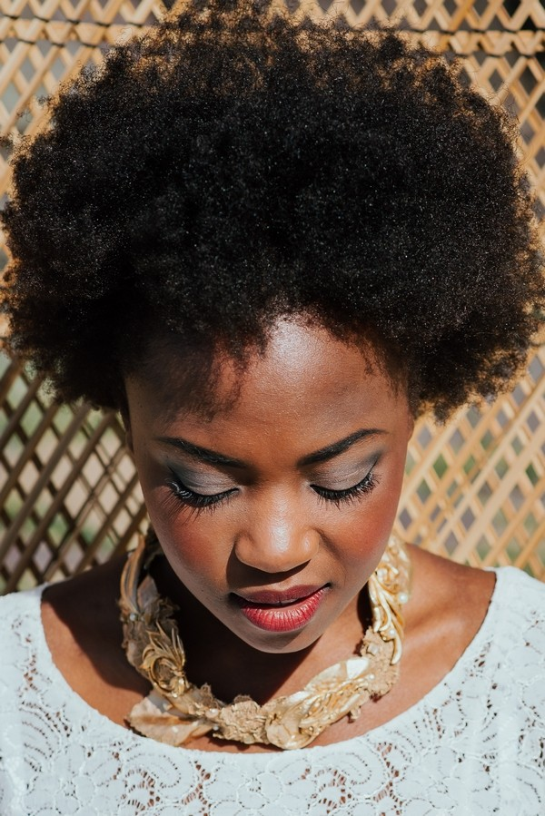 Bride with afro looking down