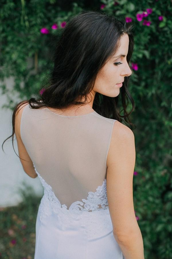 Illusion panel on back of bride's wedding dress