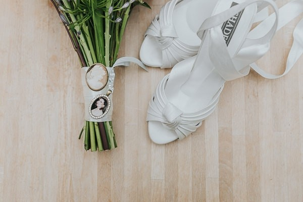 Bridal shoes and brooches on bouquet