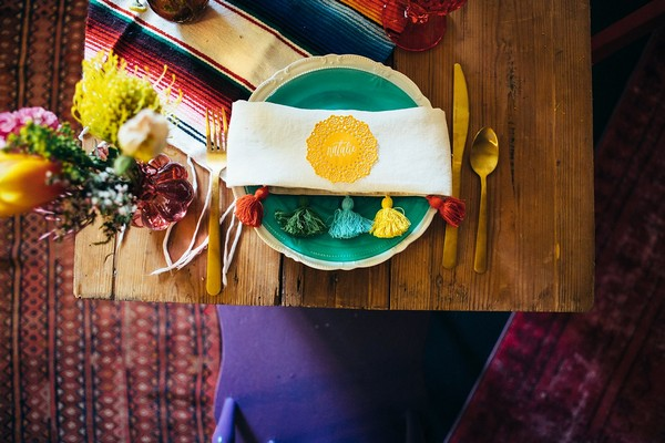 Colourful place setting with napkin with tassels