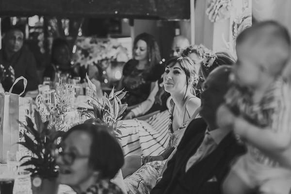 Wedding guests listening to groom speech