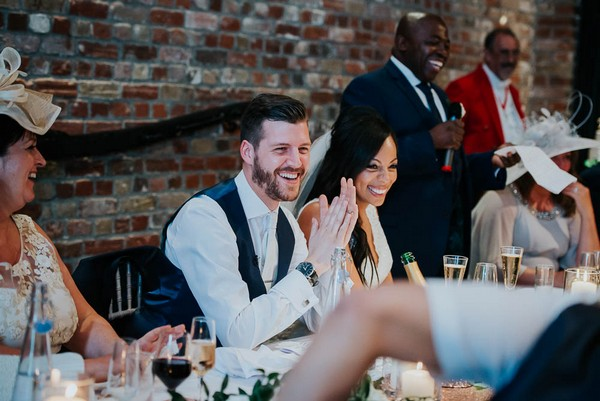 Bride and groom sitting at top table