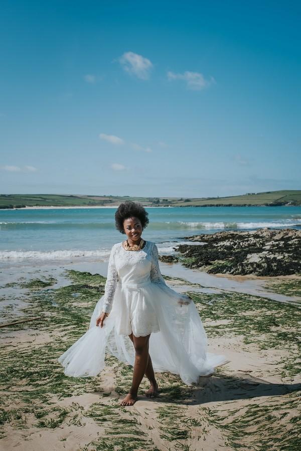 Bride walking on beach