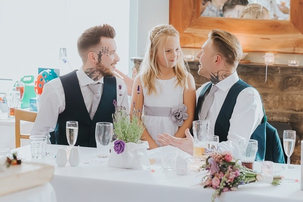 Groom and best man with flower girl