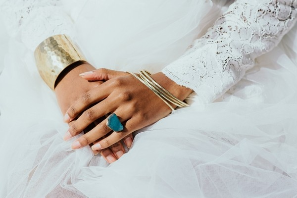 Bride's gold bracelets and blue ring