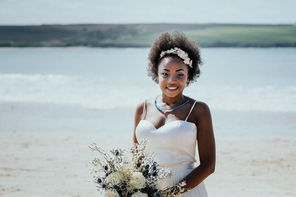 Smiling bride holding bouquet