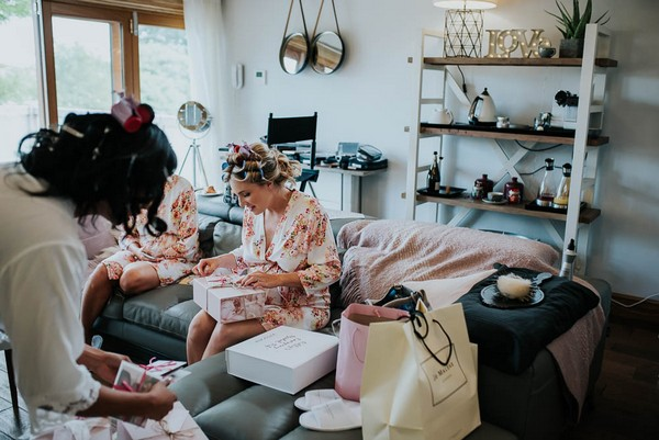 Bridesmaids opening gift boxes