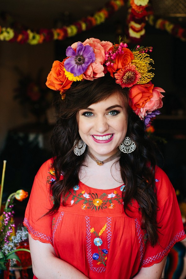 Woman wearing colourful flower crown