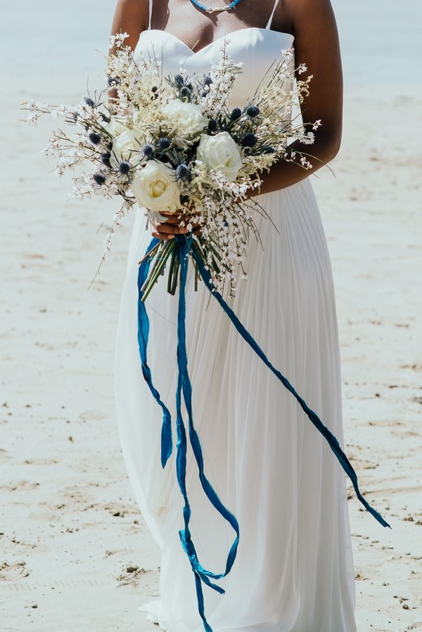 Rustic wedding bouquet with long blue ribbon