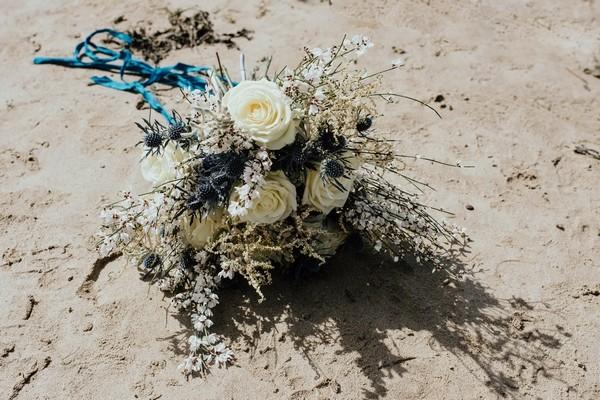 Rustic wedding bouquet on beach