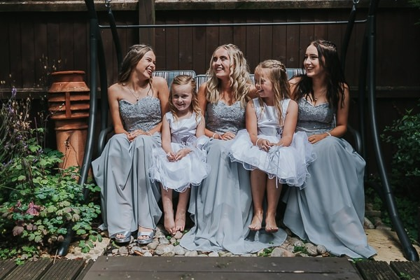 Bridesmaids and flower girls in silver/grey dresses