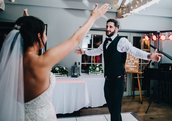 Bride and Groom on Dance Floor at Winter Wedding
