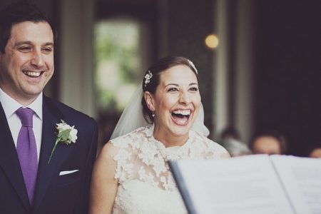 Bride and Groom Laughing During Civil Wedding Ceremony