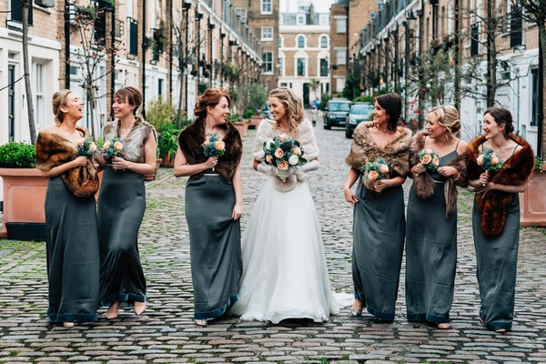 Bride and bridesmaids walking down street - Picture by Damion Mower Photography