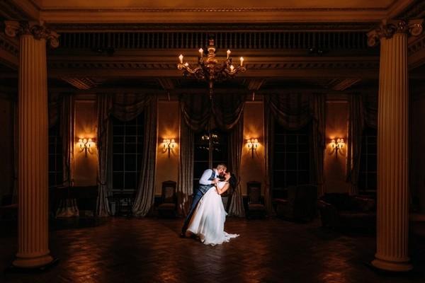 Bride and groom on dance floor in ballroom