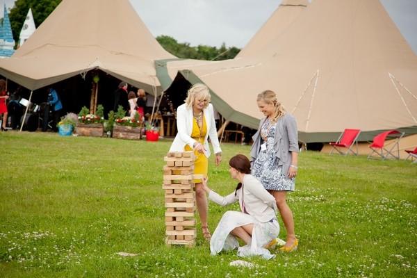 Women Playing Giant Jenga Wedding Game
