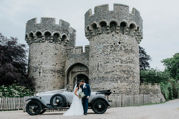 Bride and groom outside Cooling Castle Barn wedding venue