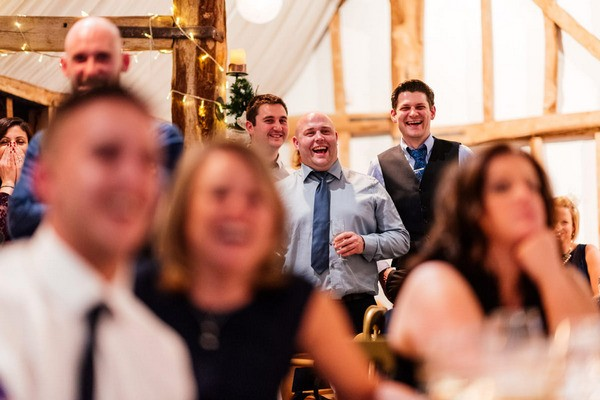 Wedding Guests Laughing at Speech at Winter Wedding