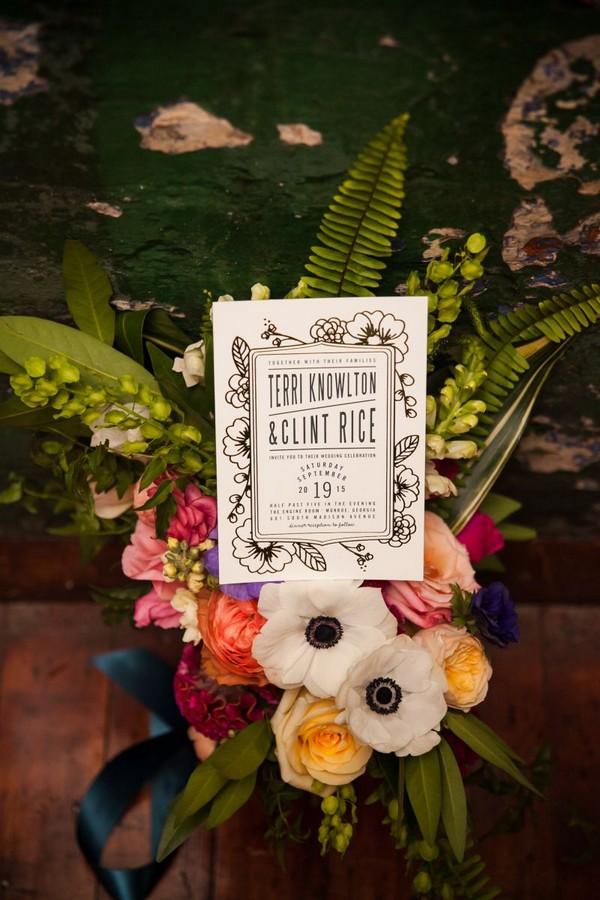 Wedding invitation on colourful flowers