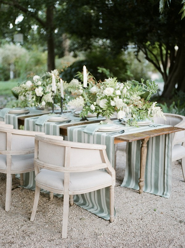 Wedding table with striped runners and floral centrepieces