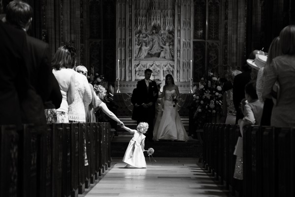 Flower girl in aisle of Sherborne Abbey