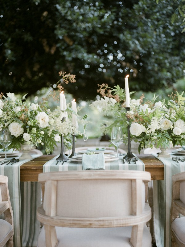 Chair at wedding place setting with flowers and candles