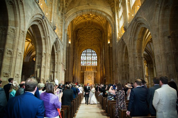 Bride and groom leaving wedding ceremony at Sherborne Abbey