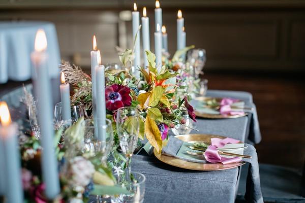 Candles and flowers down centre of wedding table