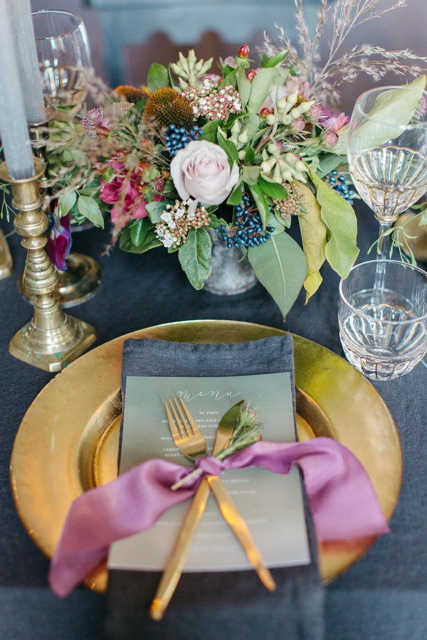 Wedding place setting with gold charger plate and cutlery