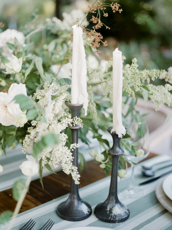 Candles and flowers on wedding table