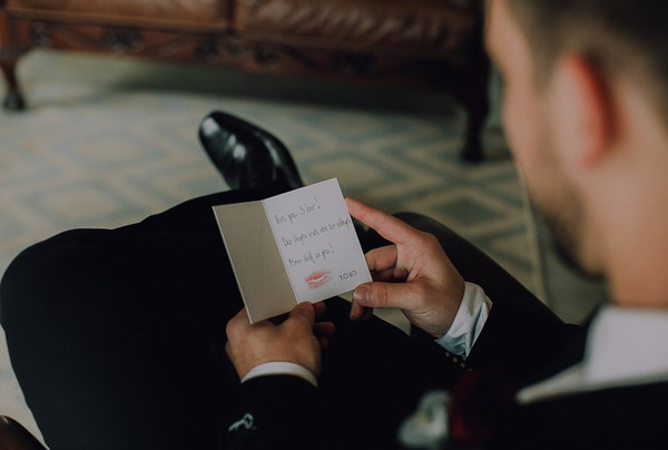 Groom reading card from wife to be