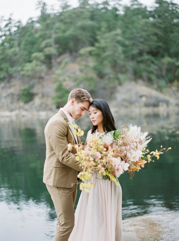 Bride and groom by water at Galiano Island