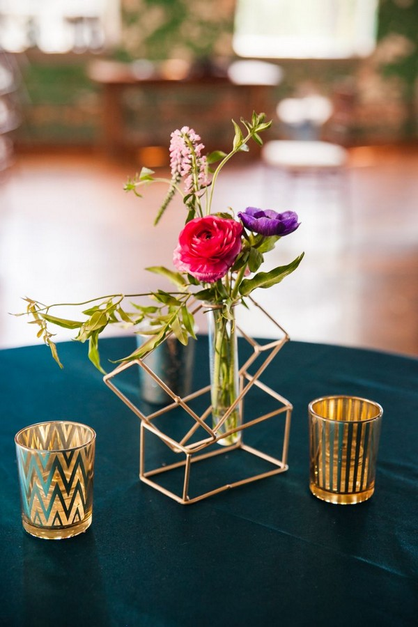 Test tube of bright flowers in geometric holder