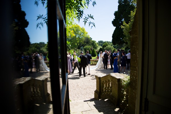 Wedding guests outside Brympton House