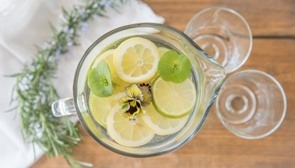 Jug of water with lemon and lime slices