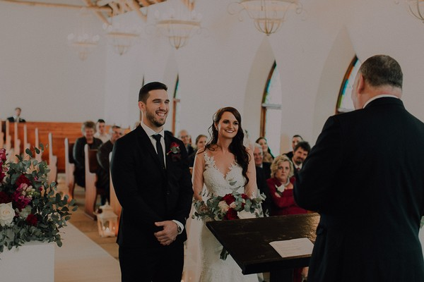 Bride and groom at altar in St. Clement's Chapel at Vondeling vineyard