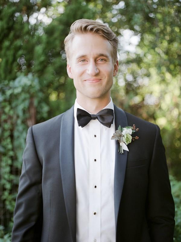 Groom wearing black bow tie