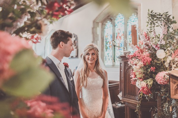 Bride smiling at groom during wedding ceremony - Picture by Michelle Lindsell Photography